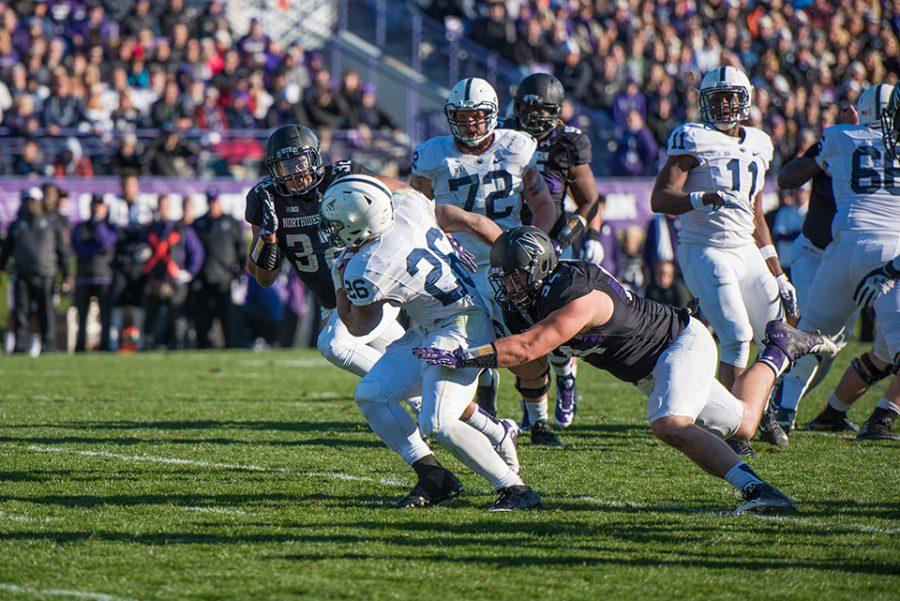 Dean Lowry lunges to tackle a ball carrier. The defensive end is hoping to be selected in the upcoming 2016 NFL Draft, held this Thursday through Saturday.