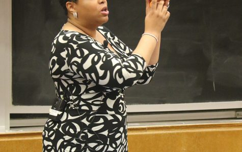 Auntie Angel, a Chicago-based sex educator, demonstrates a technique with a grapefruit. Angel spoke to roughly 200 students during an event at the Technological Institute on Friday.