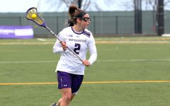 Selena Lasota cradles the ball. The sophomore midfielder has scored 26 goals through the Wildcats' first 12 games.