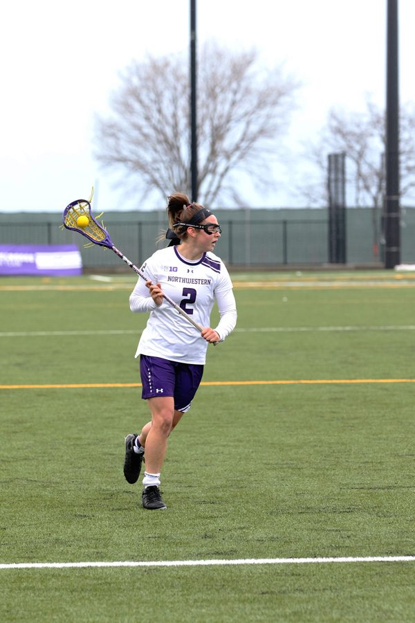 Selena+Lasota+cradles+the+ball.+The+sophomore+midfielder+has+scored+26+goals+through+the+Wildcats%E2%80%99+first+12+games.
