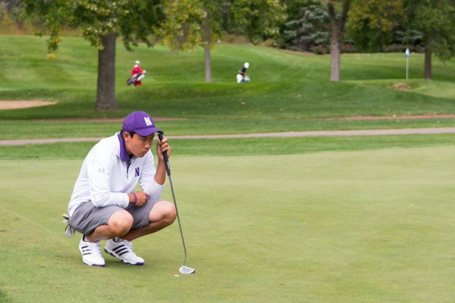 Dylan+Wu+crouches+in+preparation+of+a+putt.+The+sophomore+finished+tied+for+13th+overall+in+The+Goodwin+last+month.+