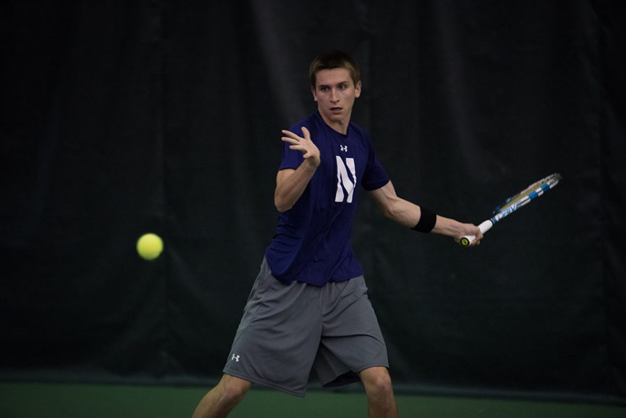 Ben+Vandixhorn+eyes+the+ball+before+a+forehand.+The+freshman+won+No.+6+singles+against+Michigan+but+did+not+finish+his+match+against+Michigan+State.+