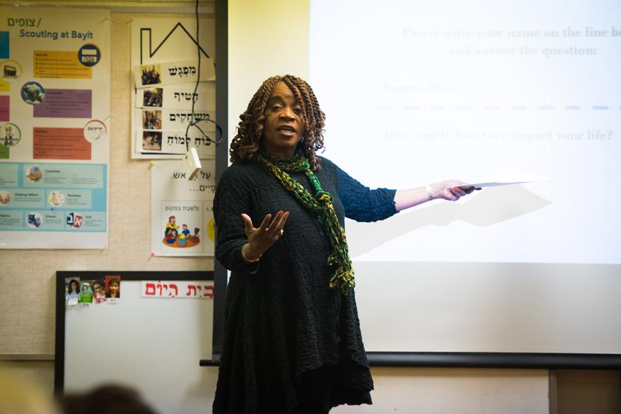 ETHS/D202 Board President Pat Savage-Williams speaks Tuesday night at an event hosted by the Organization for Positive Action and Leadership of Evanston. Savage-Williams talked about racial disparities in the education system and her own experiences at ETHS.