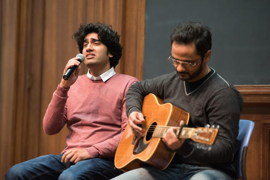Pakistani pop stars Ali Aftab Saeed, left, and Saad Sultan, right, sing in an impromptu music concert Monday night. The artists arrived at Northwestern this week to begin a two-week residency as Jean Gimbel Lane Distinguished artists.