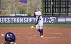 Kristen Wood delivers a pitch. The senior pitcher returned to the circle from injury last weekend, winning two of three games against Michigan State.