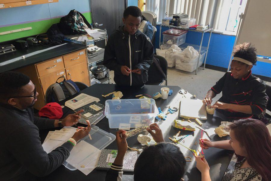Northwestern graduate student Nisan Hubbard helps his students devise a prosthetic arm out of household items during Science Club at the Pedersen-McCormick Boys & Girls Club. The program uses a hands-on approach to encourage interest in STEM education.