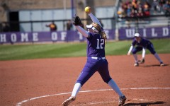 Kenzie Ellis prepares to throw the ball. The freshman pitcher was roughed up in Sunday's opening game, allowing 8 runs in 4 innings of work.