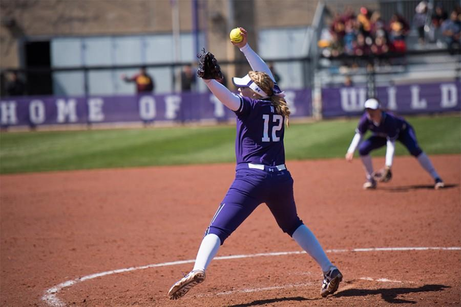 Kenzie+Ellis+prepares+to+throw+the+ball.+The+freshman+pitcher+was+roughed+up+in+Sunday%E2%80%99s+opening+game%2C+allowing+8+runs+in+4+innings+of+work.+