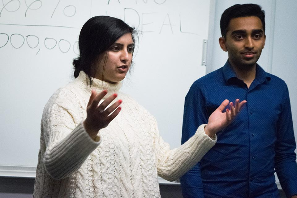 """Weinberg junior Joji Syed (left) and Weinberg sophomore Archit Baskaran lead a campaign meeting. The two are running for Associated Student Government president and executive vice president on the slogan """"A NU Deal."""""""