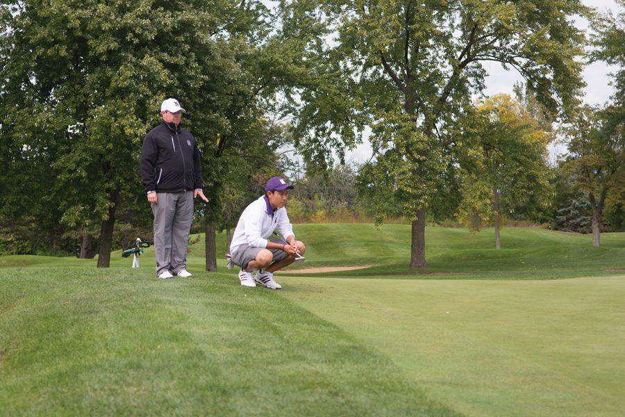 Dylan Wu eyes the green before a putt. The sophomore finished The Boilermaker at 5-under par.
