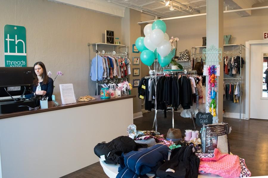 Chaya+Gordon+Burstyn+sits+at+the+counter+in+Threads+Boutique.+The+store%2C+1304+Chicago+Ave.%2C+opened+Tuesday+and+features+upscale+used+children%E2%80%99s+clothing.
