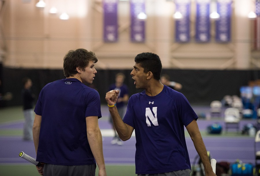 Junior Alp Horoz (left) and senior Mihir Kumar celebrate after a point. Northwestern continued its dominant start to the season, winning its fifth straight Big Ten match to open the conference schedule.