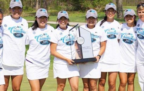 The women's golf team poses with their trophy after winning the Big Ten title. The team finished tied for first with Ohio State for the second year in a row.