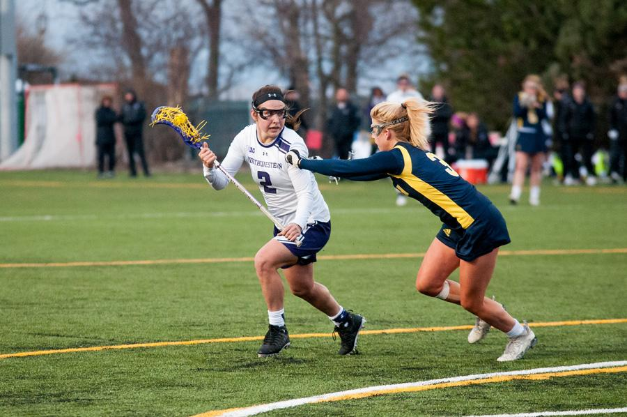 Selena Lasota works her way around a defender. The sophomore midfielder, who had been in a recent slump, tied her career high with 6 goals Thursday night.