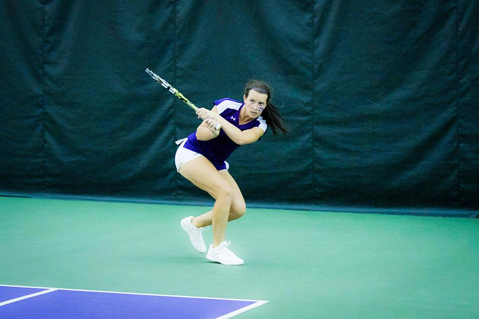Jillian Rooney hits a backhand. The junior has helped anchor the bottom half of the Cats' lineup this season and will look to do so again in the conference tournament.