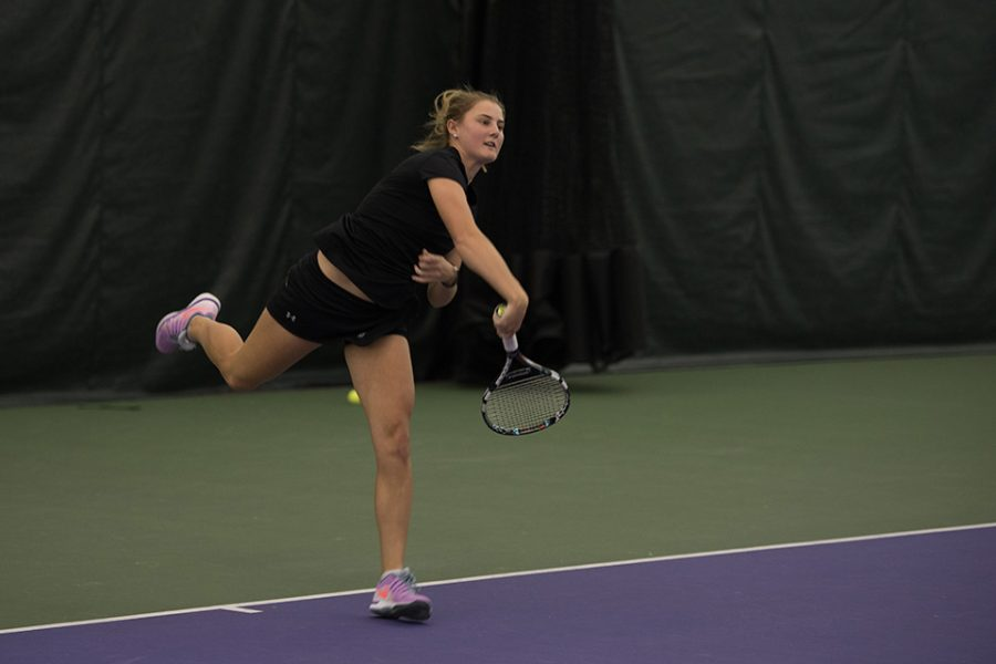 Brooke Rischbieth follows through on a serve. The junior was the first Wildcat to lose her singles match Sunday against Ohio State.