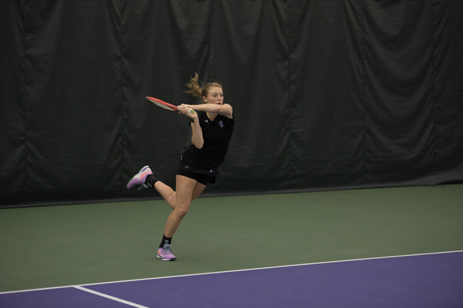 Alicia Barnett smashes a backhand shot. The senior will play her final regular-season home match in Evanston this Friday against Michigan.