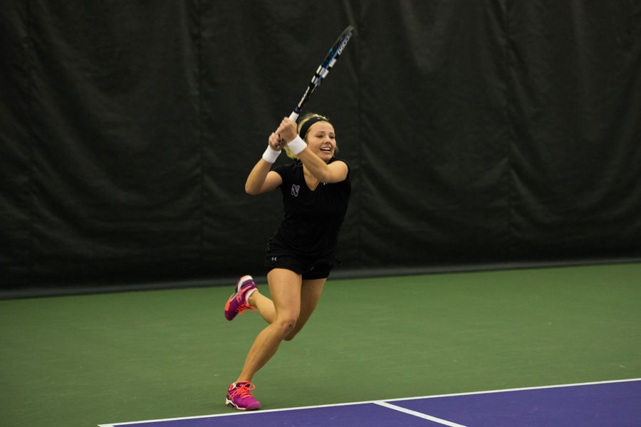 Alex Chatt admires a backhand shot. The sophomore is 3-3 in her in-conference singles matches so far this season.