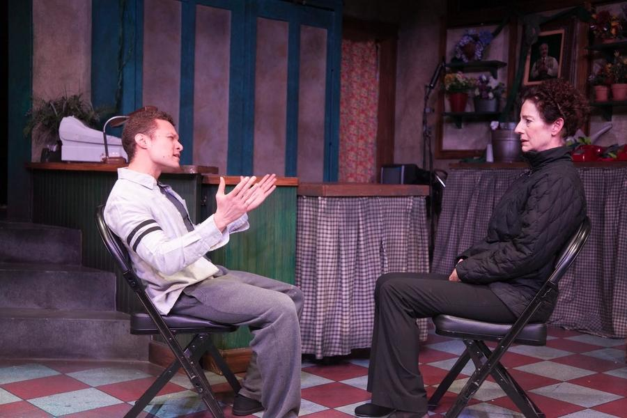 Roberto Jonson (left) talks to Carmen Roman as they play mother and son in the short play