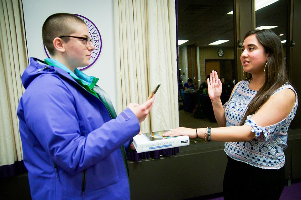 Associated Student Government president and SESP junior Christina Cilento (left) swears in SESP junior Anna DiStefano as a co-vice president for student life at Wednesday's Senate meeting. Senate rejected the nomination of SESP sophomore Sumaia Masoom as the other co-vice president for student life.