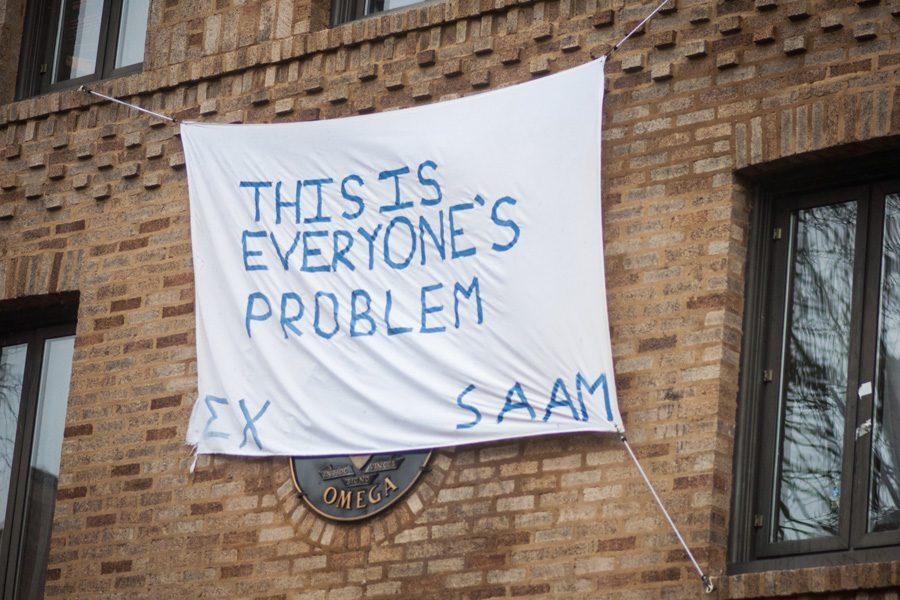 A+banner+hangs+outside+Sigma+Chi%E2%80%99s+on-campus+house.+The+banners+were+created+to+observe+Sexual+Assault+Awareness+Month%2C+but+some+students+found+them+to+be+in+poor+taste.