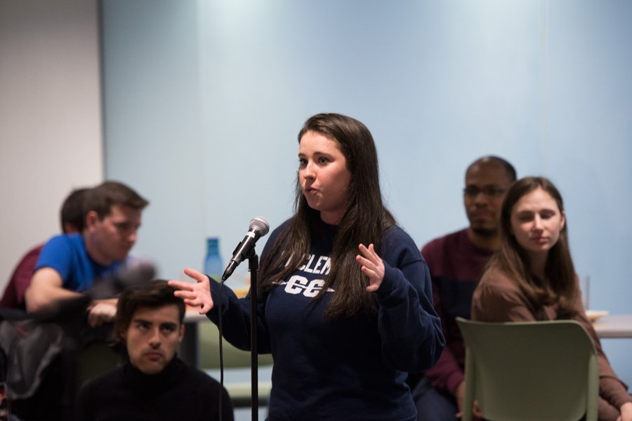 Communication senior Amanda Walsh speaks at Allison Hall on Monday evening. Walsh spoke during the latest community dialogue, at which students shared comments and concerns with top administrators.