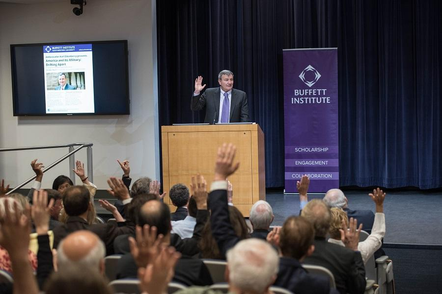 Former ambassador Karl Eikenberry asks the audience to raise their hands if they or a family member have served in the military. Eikenberry spoke about the growing divide between the United States military and the country's citizens during a talk held Tuesday.