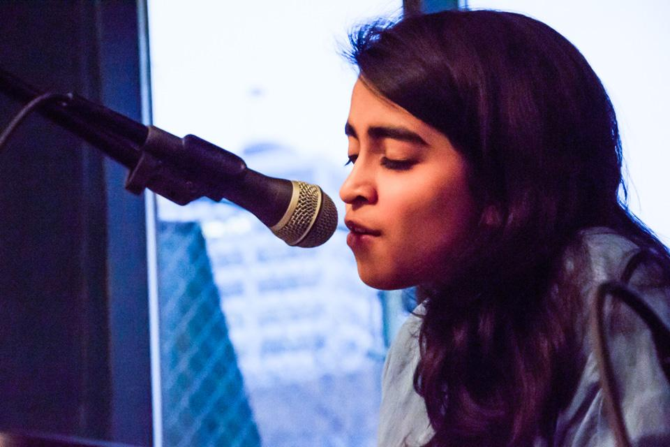 "Weinberg freshman Chaitra Subramaniam performs a song. She will perform in ""Camp(us) Fire,"" a benefit concert that aims to combine an understanding of global health with performance."