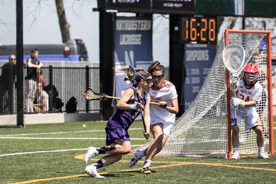 Christina Esposito tries to evade a defender. The junior attacker led the Wildcats with 3 goals in Sunday's loss to Maryland.