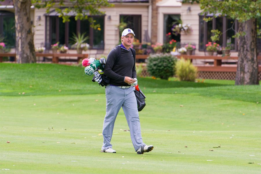 Josh Jamieson walks across a golf course. The NU senior is looking to finish his collegiate golf career strong, as the Cats prepare for the NCAA Tournament.