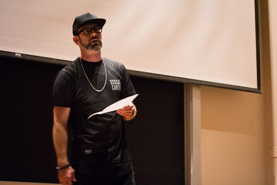 Kevin Coval, a co-founder of Louder Than a Bomb, speaks at Fisk Hall on Thursday. Coval spoke at an event hosted by Northwestern Community Development Corps that showcased young Chicago-area poets.