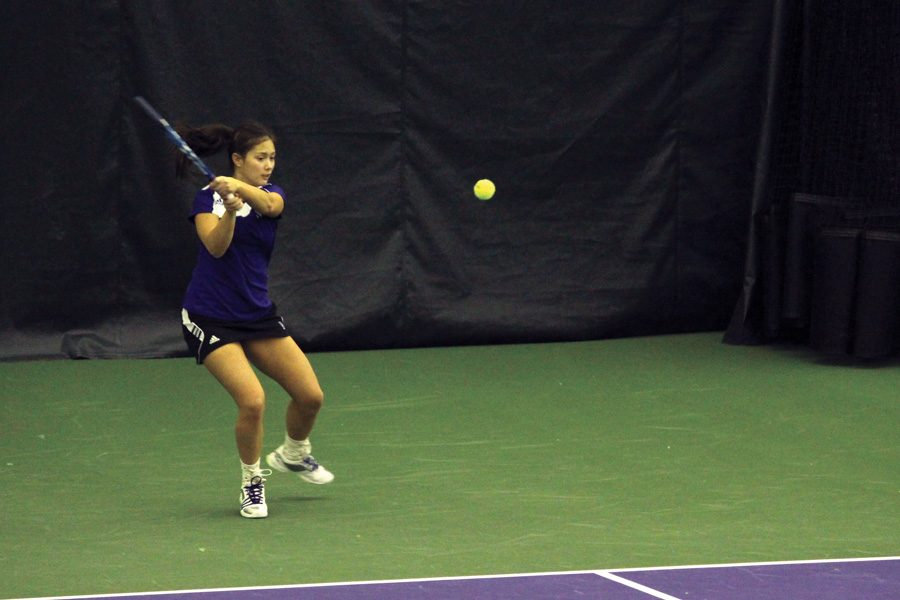 Nida Hamilton hits a backhand during her time as a student-athlete. Hamilton last played for the Wildcats in 2014 and is now a volunteer assistant coach.