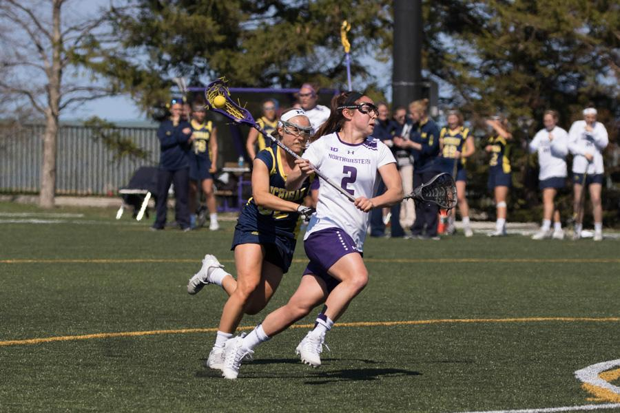 Selena Lasota runs from a defender. The sophomore midfielder scored 3 goals Thursday afternoon, tied for the team lead.