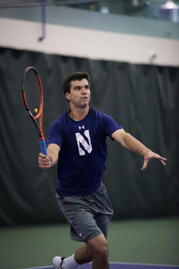 Konrad Zieba hits a volley. Northwestern's top-ranked singles player will look to lead the team to the tournament's main stage in Tulsa, Oklahoma.