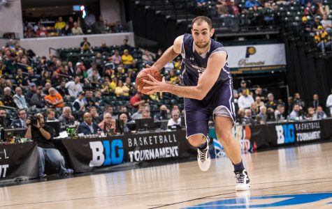 Alex Olah drives down the court. The former NU player and his teammate Tre Demps will be playing together professionally for Belfius Mons-Hainaut in Belgium.