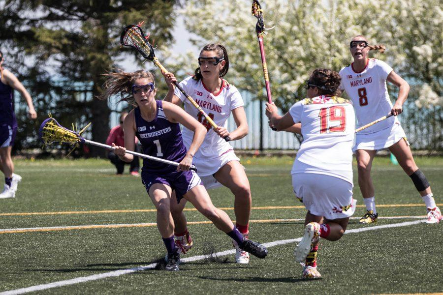 Catie Ingrilli is swarmed by Maryland defenders. The junior midfielder was unable to get things going on offense, only taking one shot in the loss.