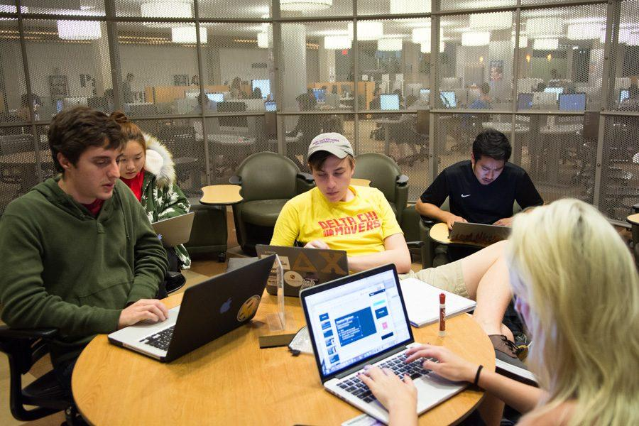 Members of the House by Northwestern team meet in University Library on Thursday night. The team plans to enter the U.S. Department of Energy's 2017 Solar Decathlon.