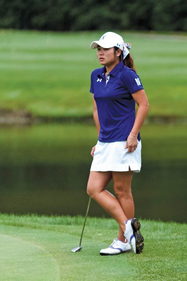 A Northwestern golfer prepares her next shot. The Wildcats fell one stroke shy of advancing in the NCAA Tournament.