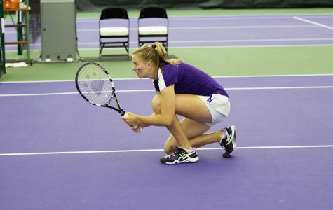 Erin Larner kneels before a doubles point. The sophomore is part of the Wildcats' three-headed sophomore monster with a 9-6 record at the No. 1 singles spot.