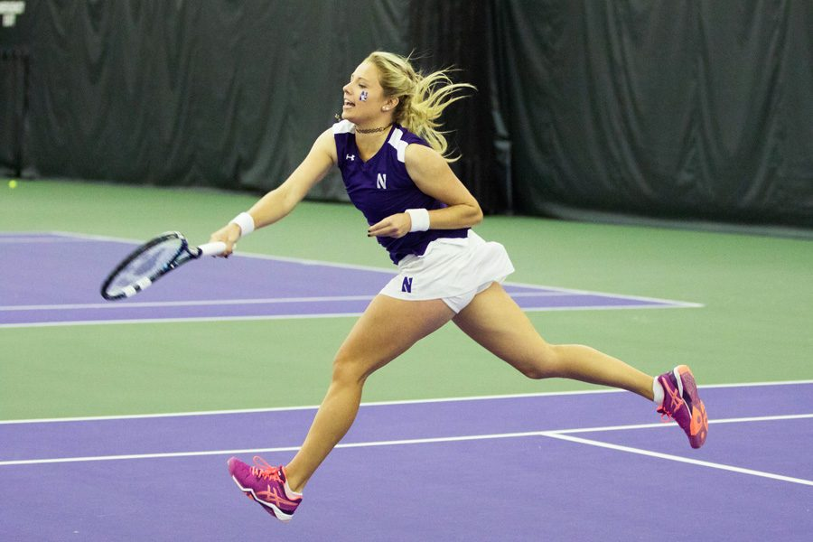 Alex Chatt lunges forward to return the ball. The sophomore won her singles match against North Carolina, but couldn't carry the team to victory.