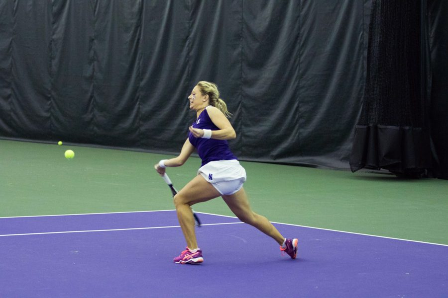 Alex+Chatt+lunges+in+a+forehand+shot.+The+sophomore+dropped+her+semifinal+singles+match+in+straight+sets+Saturday.