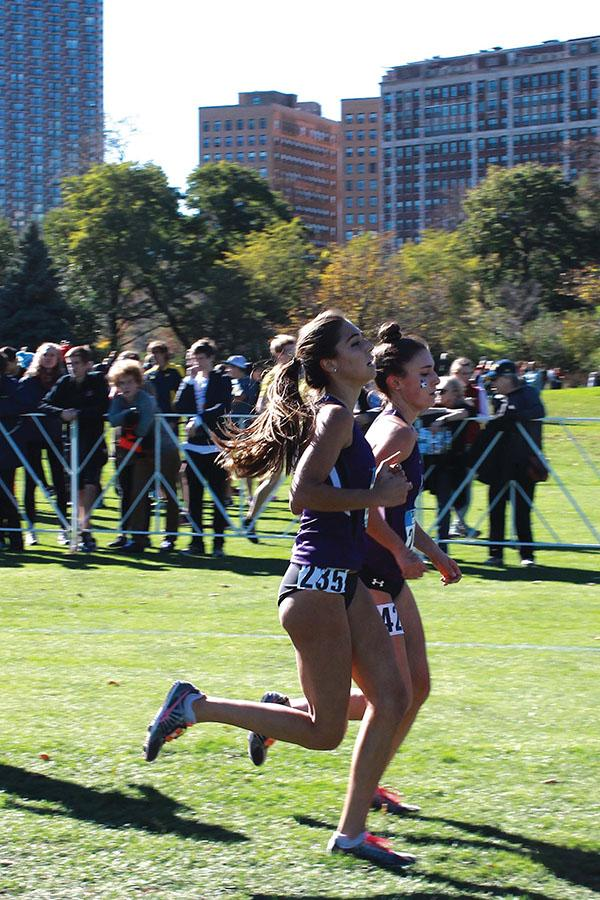 Two Northwestern runners compete in a race. The Wildcats will run in nearby Naperville, Illinois a few weeks after racing in Champaign.