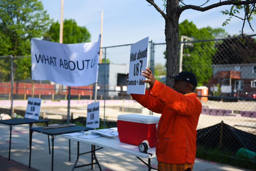 """A protestor holds a sign asking """"What about Us?"""" during a protest over Youth & Opportunity United contracting for construction of its new center at 1911 Church St. Organizers said the protest aimed to showcase community concern over lack of employment opportunities for local minority workers."""