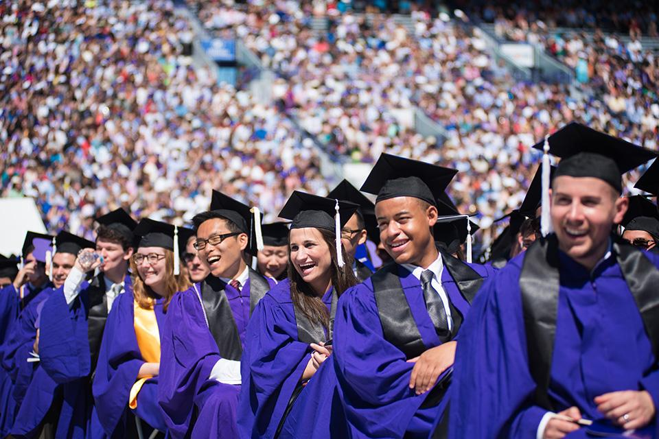 Graduates laugh at Meyers' jokes and remarks. The comedian got his start with NU's comedy group Mee-Ow.