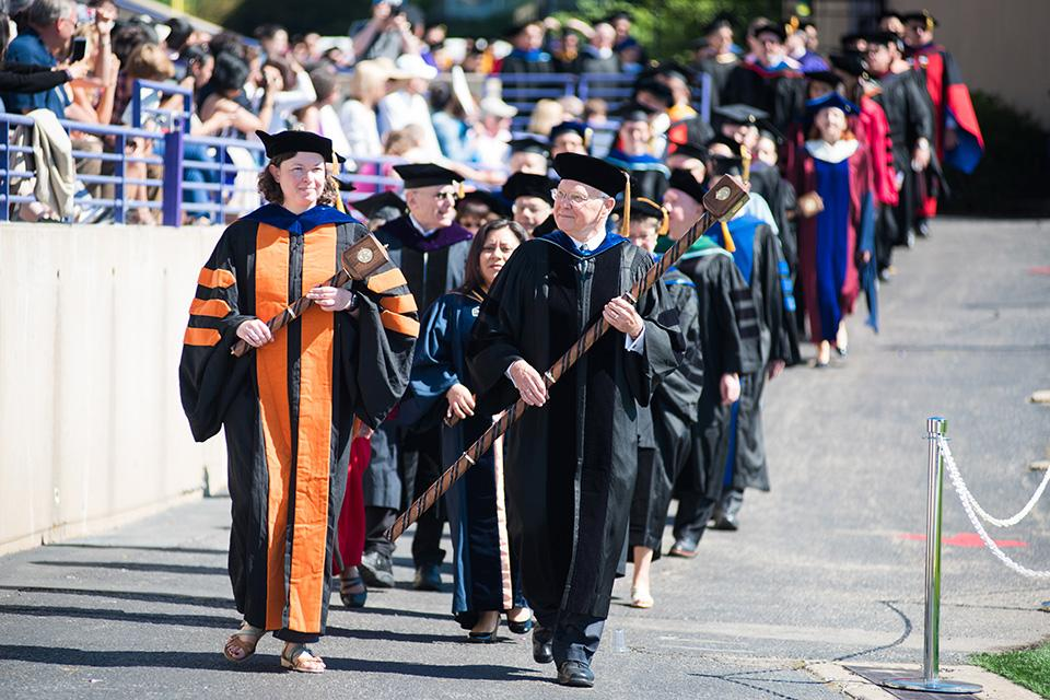 Faculty members march into Ryan Field. Thirty-four professors received emeritus status during the ceremony.