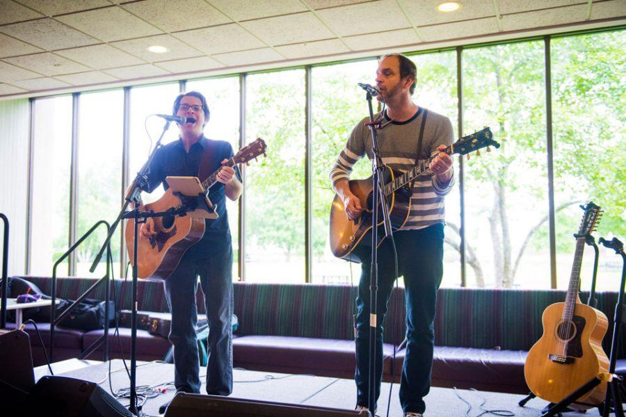 Tommi Zender and Phil Angotti play classic rock music inspired by The Beatles. The two local artists kicked off Lunch on the Lake, a six-week series of noontime concerts featuring live music and BBQ food.