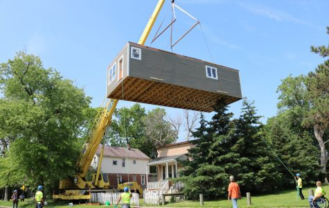 Evanston Township High School construction class relocates home it built during course