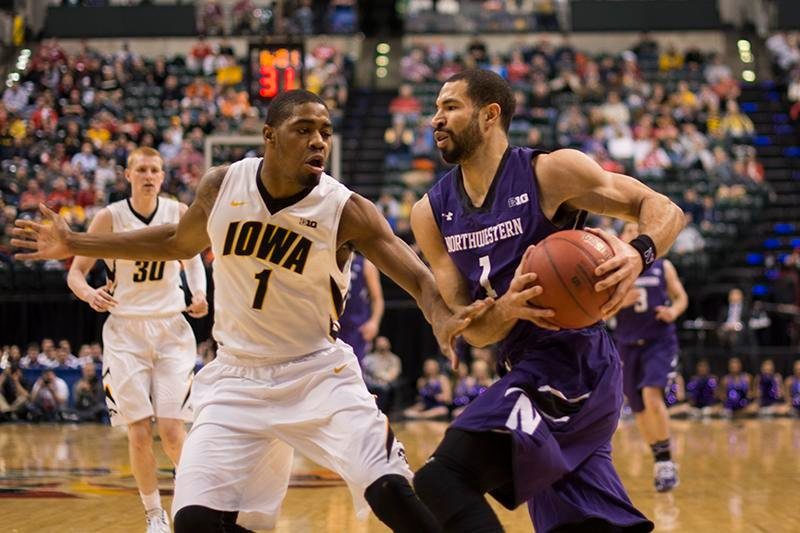 Former Wildcat guard Drew Crawford attacks the paint in a 2014 game. Crawford is one of three Northwestern alumni slated to play in The Basketball Tournament for a team put together by former Cats Tim Doyle and Craig Moore.