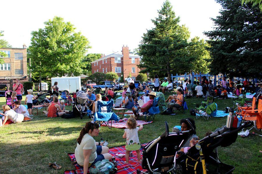 Community members eat a variety of foods in Brummel Park, where 10 food trucks lined up Tuesday night for the annual Food Truck Fest and Starlight Concert.