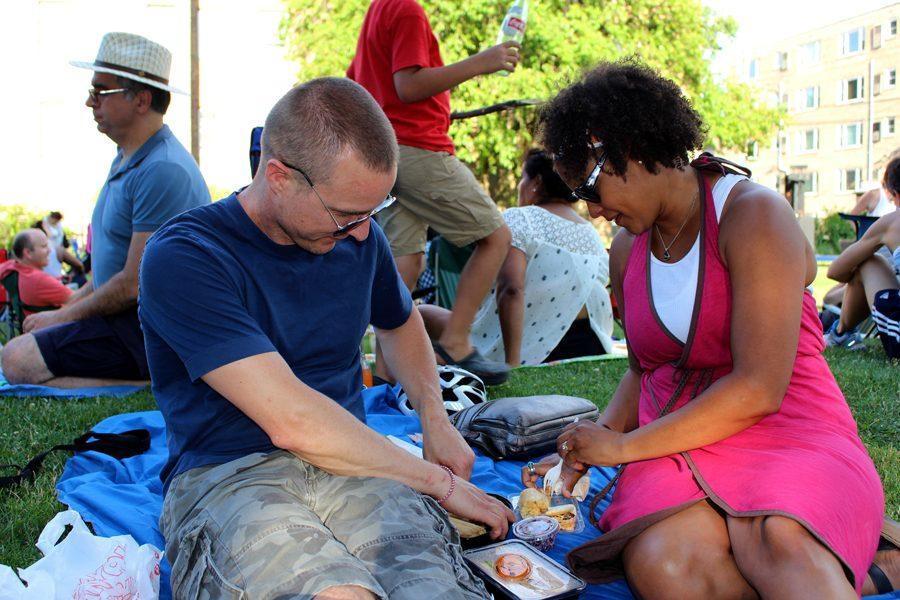 "Evanston residents Bobby (left) and Shannon Lang enjoy food from Piko Street Kitchen, Tamale Spaceship and Grill Chasers. ""We first learned about (the event) through friends, so now when anyone hears that it's coming up we all email each other,"" Shannon Lang said. ""We love it; it's food, music and community."""